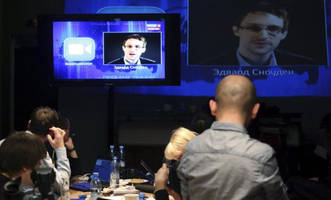 Edward Snowden talks to Russian president Vladimir Putin